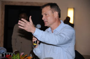 Race car driver David Summerbell makes his suggestion during the luncheon.